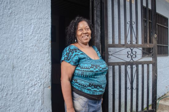 Norys Orozco standing in front of her home in the San Blas barrio, Photograph by Stephanie Marcelot.