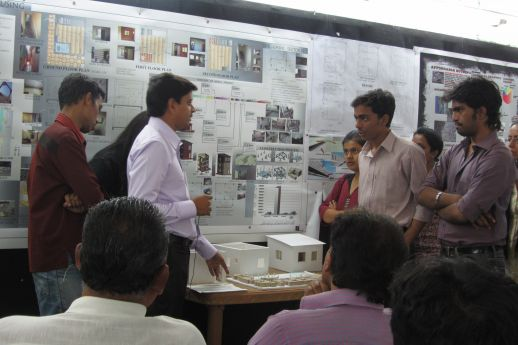 Contractor Pankaj Gupta discussing construction techniques with students.