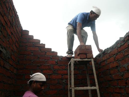 Brickwork being laid on top floor of the documented house, Plot 22