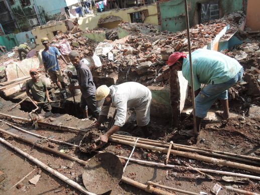 Men at work at Jairam Seth Chawl in Dharavi Koliwada