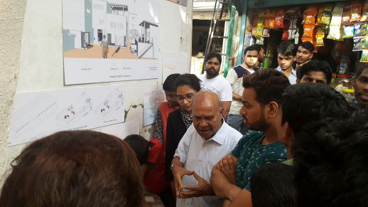 Life-long Dharavi resident and activist, Bhau Korde explaining some of the ideas developed by the urbz team to residents of Bareilly Compound.