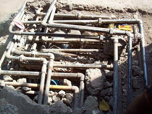 Network of pipes carrying fresh water to the houses. These pipes have all been laid out by local plumbers.